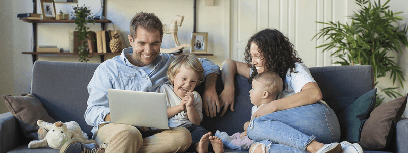 Family together on laptop