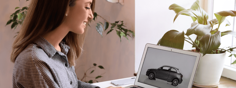 Lady looking at car on laptop