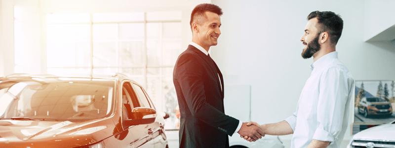 Men shaking hands in showroom