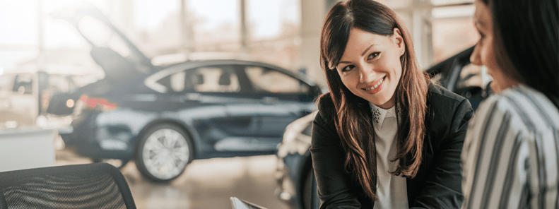 Lady at car showroom